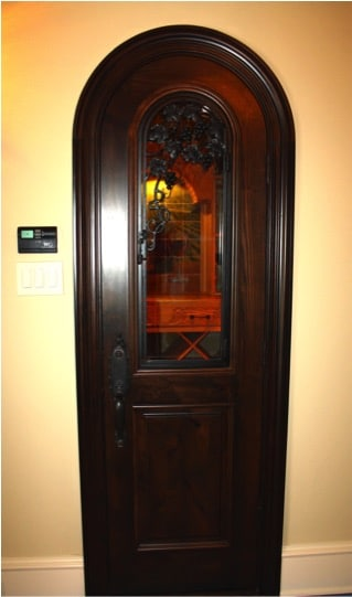 4. Custom Grapevine Carved Door in Colleyville, Texas Wine Room