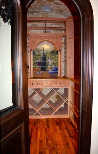 Doorway of Wine Room Showing Wine Barrel Flooring and Wood Racking