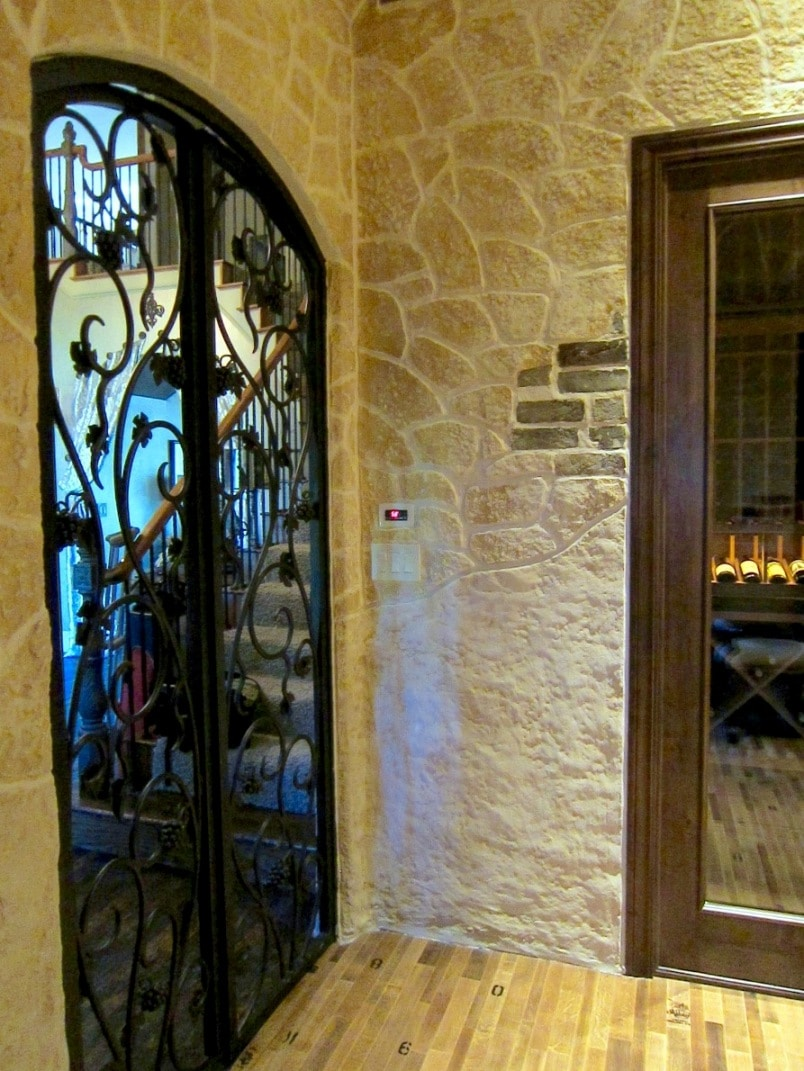 Texas wine cellar door made from iron gate and glass
