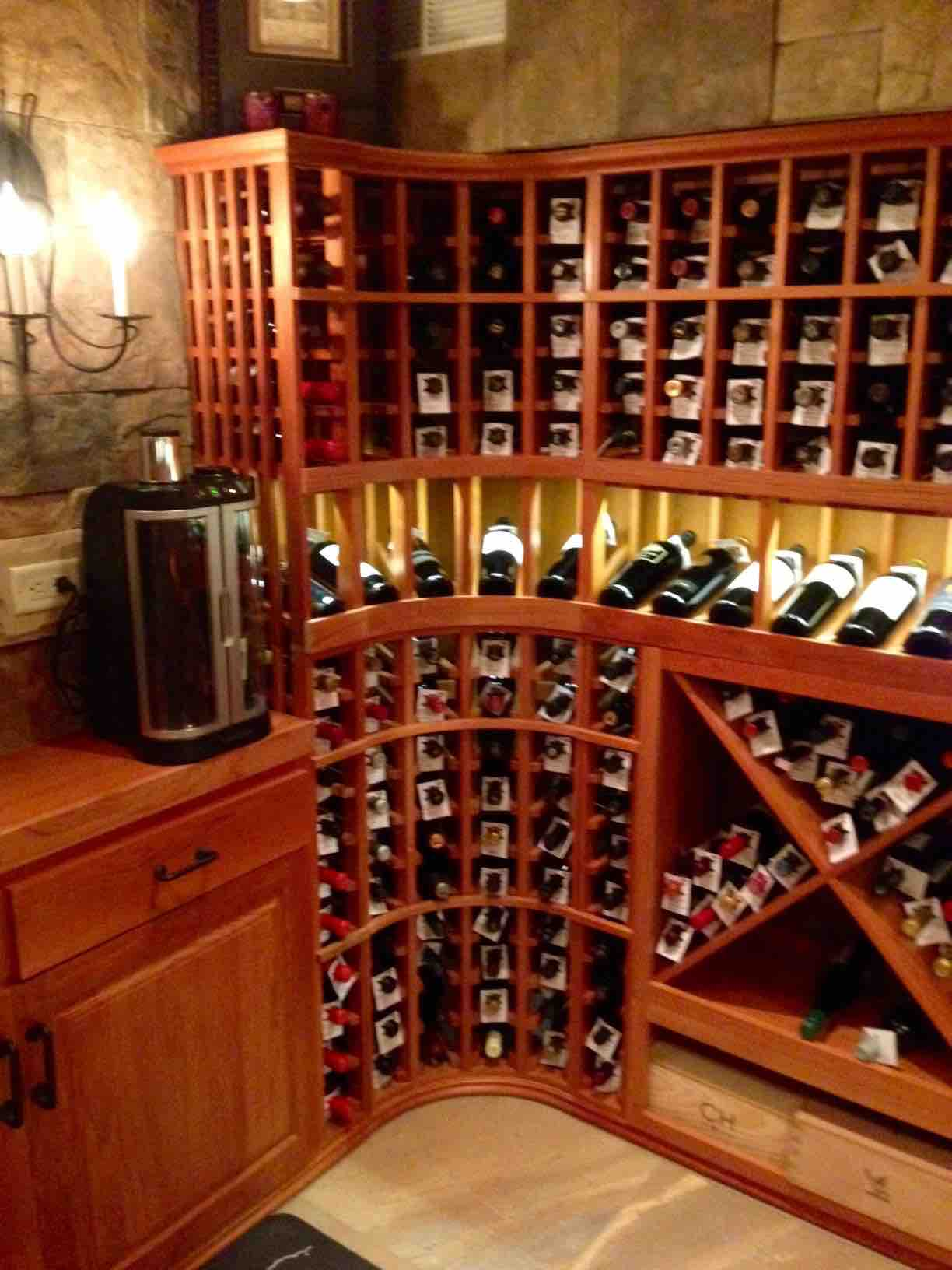 Curved Wine Rack Corner with Lighted Display Row in Illinois Home Wine  Cellar