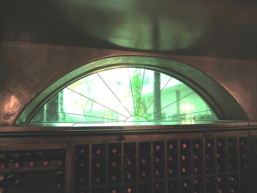 Houston Home Wine Cellar Sunburst Window Left Wall