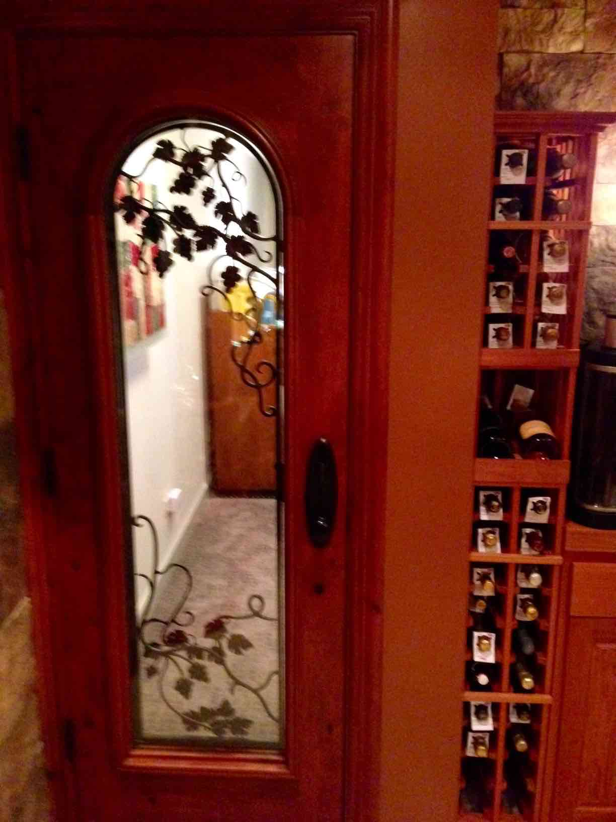Custom Wine Cellar Door with Wrought Iron Grapevine Design Florida Builer