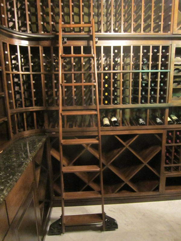 Bent library ladder with Sunburst wheels Houston Wine Cellar