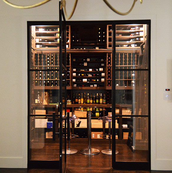 Finished Custom Wine Cellar with Wooden Racks and Glass Door